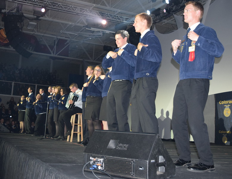 "State FFA officer candidates do the ""Chicken Dance"" as Adam Davis, of the Peetz FFA chapter, performs on his accordion before the start of the fourth session at the Colorado FFA State Convention Wednesday, June 8, 2016."