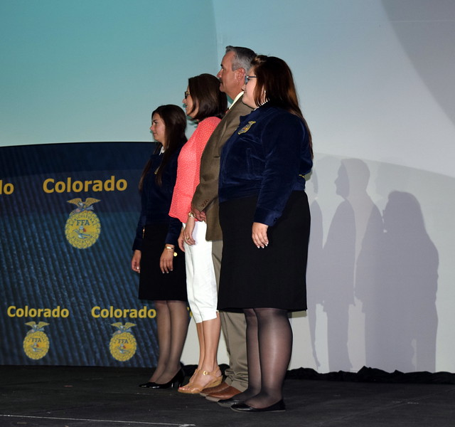 Mike Anderson, chair of the agriculture department at Northeastern Junior College, and Marci Henry, athletic director, receive Honorary FFA Degrees during the fourth session of the Colorado FFA State Convention Wednesday, June 8, 2016.