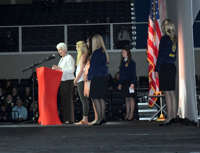 Mary Lou Chapman, executive director of the Colorado Young Farmers Educational Association, announces scholarship recipients during the second session of the Colorado FFA State Convention Wednesday, June 8, 2016.
