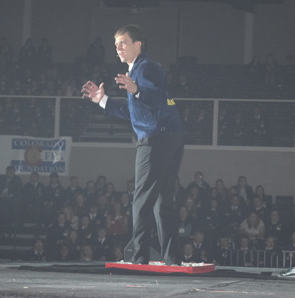 "Colorado FFA State Sentinel Nick Vollmer, of Merino, demostrates the theme of session 2, ""Intensify Your Experience,"" as he walks across broken glass during the Colorado FFA State Convention Wednesday, June 8, 2016."