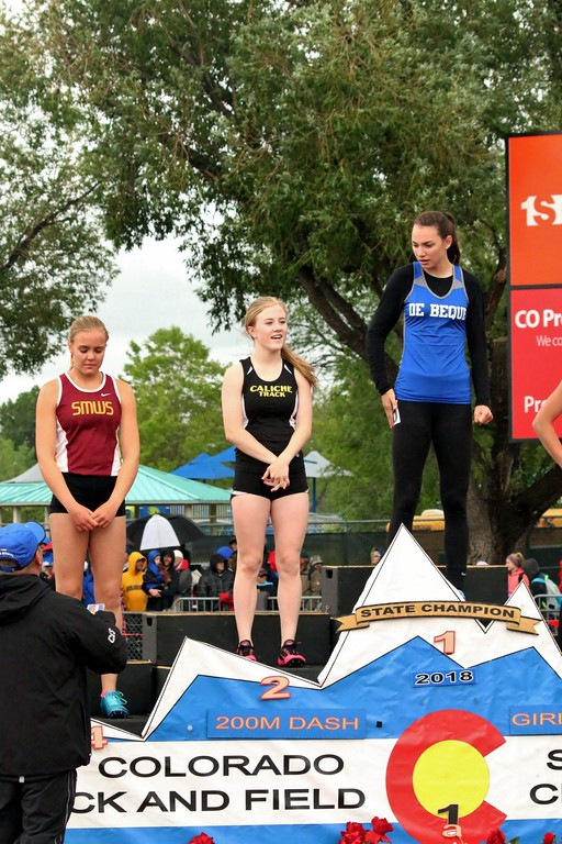 . Cristen Houghton of Caliche High School takes the podium after placing second in the 200 meter dash at the state meet over the weekend in Lakewood. (photo by Melanie Kindvall)