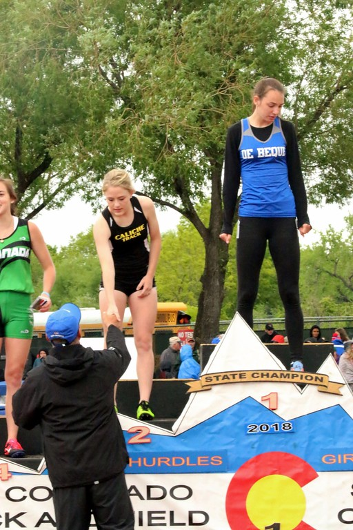. Kaitlyn Houghton of Caliche High School get a medal on the podium after taking second place in the 300 meter hurdles. (photo by Melanie Kindvall)