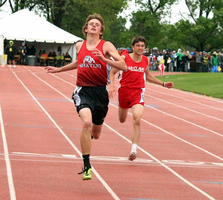 . Ryan Schaefer of Haxtun High School finishes a running event at the state meet over the weekend in Lakewood. (photo by Melanie Kindvall)