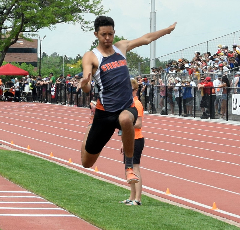 . Jayson Frank of Sterling High School flies through the air during an attempt in the triple jump at the state meet in Lakewood. (photo by Kyle Inman)