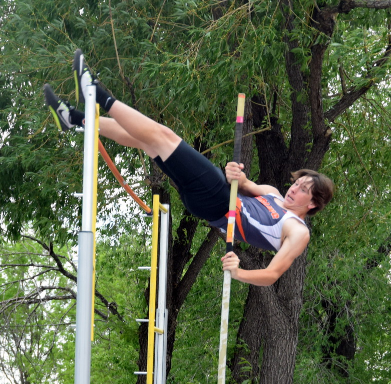 . Conner Polenz of Sterling High School vaults himself up and over the bar during a pole vault attempt in Lakewood at the state meet.