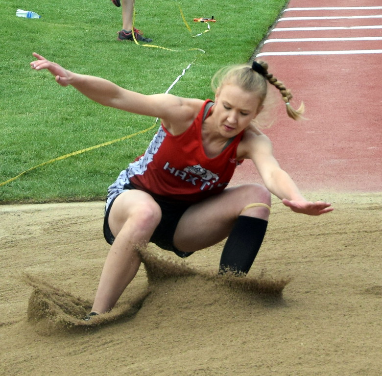 . Dawson Knode of Haxtun High School lands an attempt in the triple jump at the state meet over the weekend. (photo by Kyle Inman)