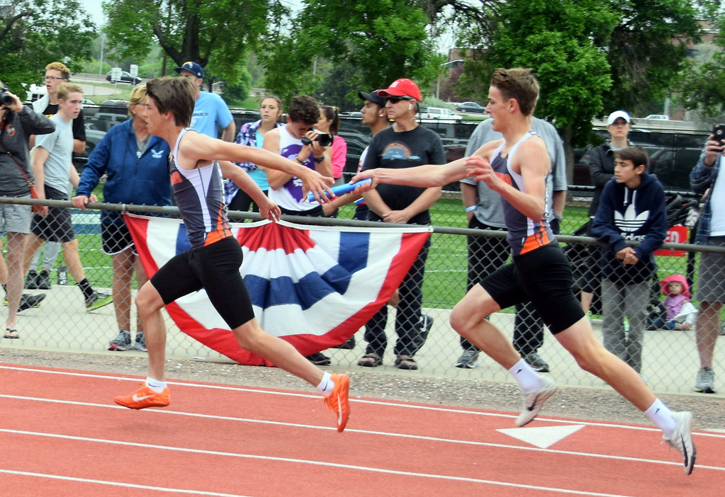 . Bryce Gilliland of Sterling High School hands the baton off the Axel Henry during the 4x200 meter relay race. (photo by Kyle Inman)