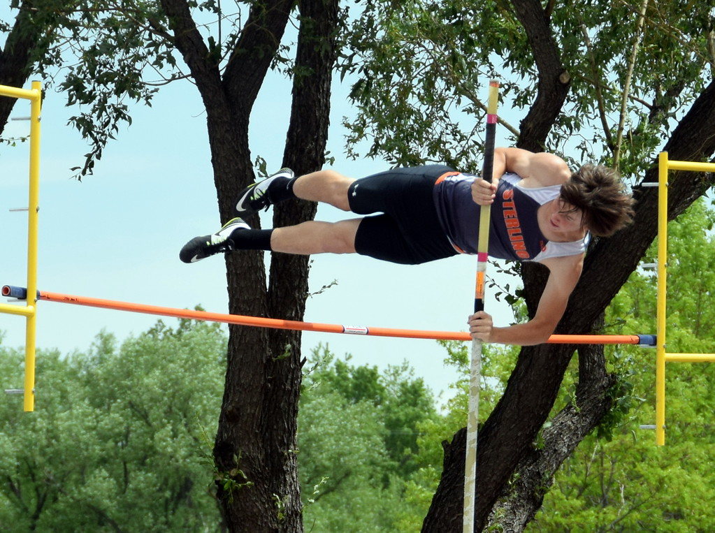 . Conner Polenz of Sterling High School clears the bar during a pole vault attempt at the state track meet in Lakewood over the weekend. (photo by Kyle Inman)