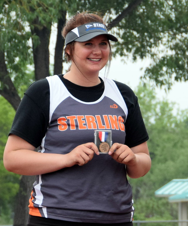 . Alexis Brower of Sterling High School stands on the podium after taking fourth place in the discus throw in Lakewood. (photo by Kyle Inman)