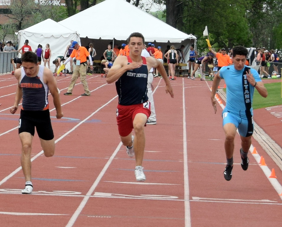 . Isaac Harris (left) of Sterling High School leans into a finish during the 100 meter dash at the Colorado State Track and Field Championships over the weekend. (photo by Kyle Inman)