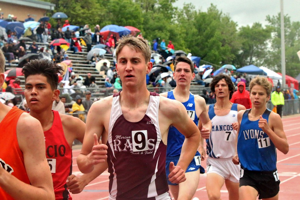 . Zach Karg (center No. 9) of Merino High School runs during the 1,600 meter race at the state meet in Lakewood over the weekend. (photo by Melanie Kindvall)