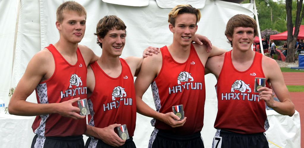 . The Haxtun 4x200 meter boys relay ream (from left) Braden Anderson, Jaxon Brown, Dalton McMurrin and Ryan Schaefer took first place at the state meet. The team set a new Class 1A state meet record with a time of 1:32.93. (photo by Kyle Inman)