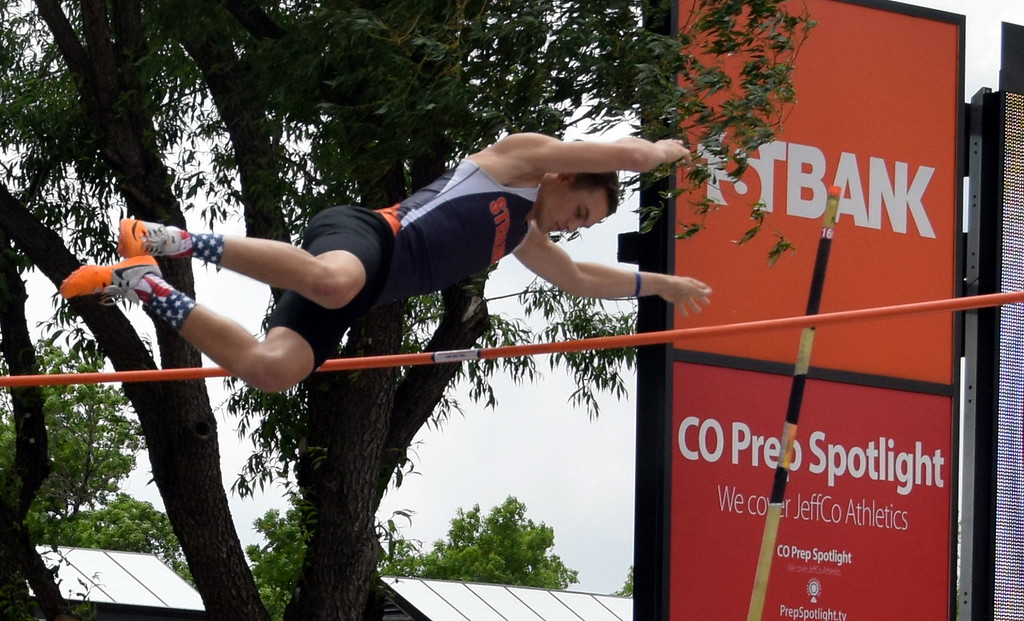 . Liam Skerjanec of Sterling High School goes over the bar during a pole vault attempt at the state meet. (photo by Kyle Inman)