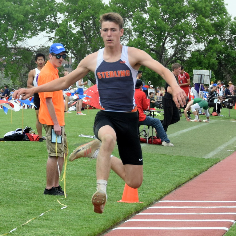 . Bryce Gilliland of Sterling High School goes up for an attempt in the triple jump at the state meet in Lakewood over the weekend. (photo by Kyle Inman)