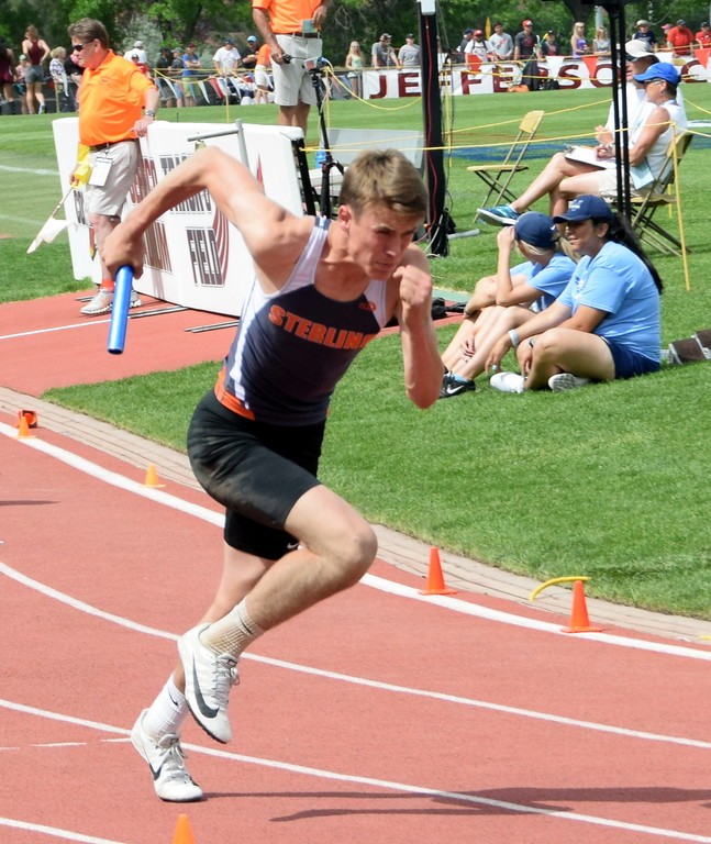 . Bryce Gilliland of Sterling High School runs the first leg of the 4 x 200 meter relay race in Lakewood over the weekend. (photo by Kyle Inman)
