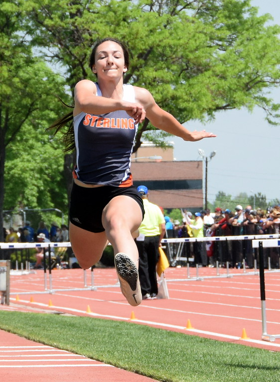 . Valarie Allen of Sterling High School goes up for an attempt in the triple jump at the state meet in Lakewood over the weekend. (photo by Kyle Inman)