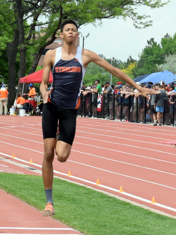 . Jayson Frank of Sterling High School gains momentum during an attempt in the triple jump during the state meet in Lakewood. (photo by Kyle Inman)