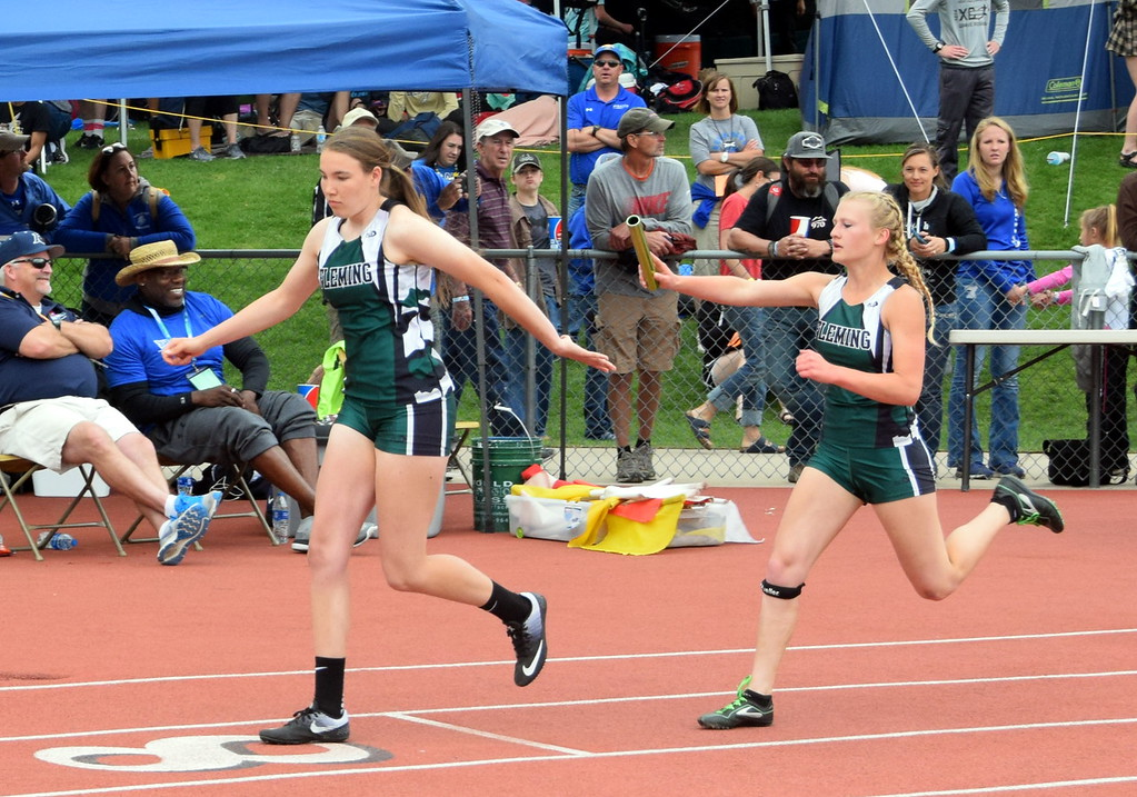. Morgan Cockroft hands off the baton to Kendyl Kirkwood for the Fleming High School girls relay team at the state meet in Lakewood over the weekend. (photo by Kyle Inman)