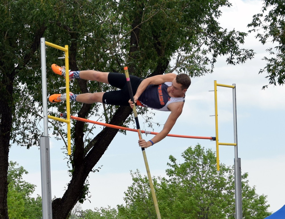 . Liam Skerjanec of Sterling High School clears the bar during a pole vault attempt at the state meet in Lakewood. (photo by Kyle Inman)
