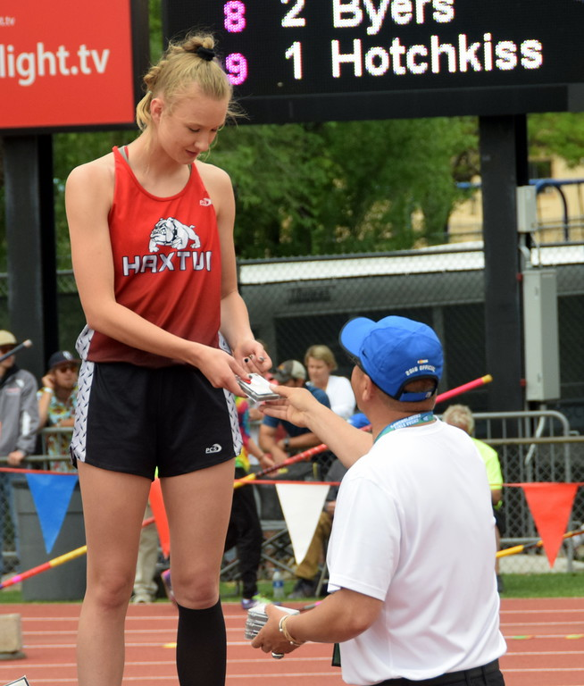 . Dawson Knode of Haxtun High School receives a medal on the podium after competing in the triple jump. (photo by Kyle Inman)