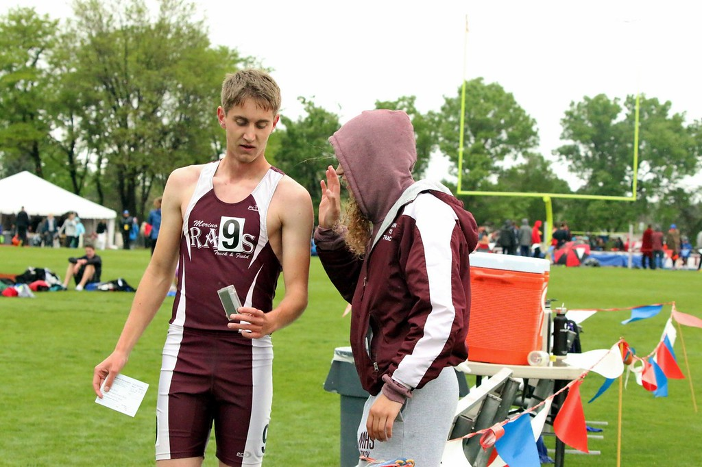 . Zach Karg of Merino High School (left) takes a look at his medal after taking the podium at the state track and field championships over the weekend. (photo by Melanie Kindvall)
