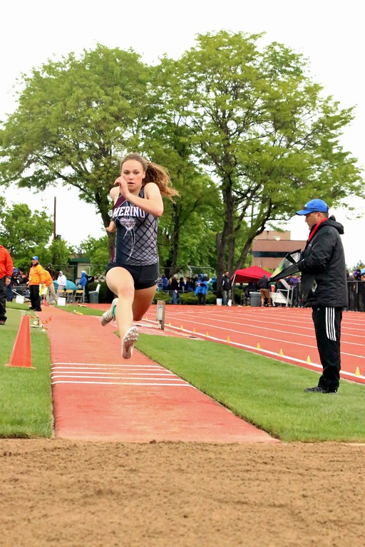 . Brooke Mertens of Merino High School competes in the triple jump at the state meet in Lakewood. (photo by Melanie Kindvall)