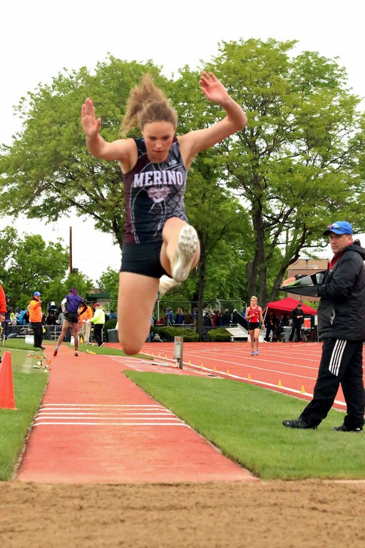 . Brooke Mertens of Merino High School goes up in the air for an attempt during the triple jump at the state meet. (photo by Melanie Kindvall)