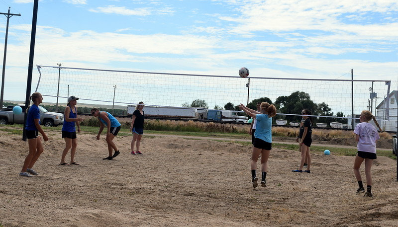 Teams warm up before the start of the LeBlanc/Stieb Memorial Volleyball Tournament at the Crook Fair Saturday, June 29, 2017.