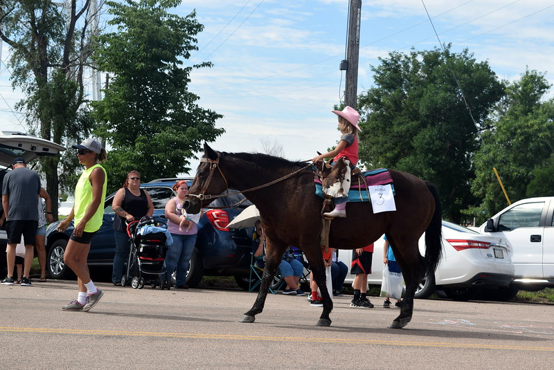 Addyson Harms makes her way down the Crook Fair Parade route on horseback Saturday, July 29, 2017.