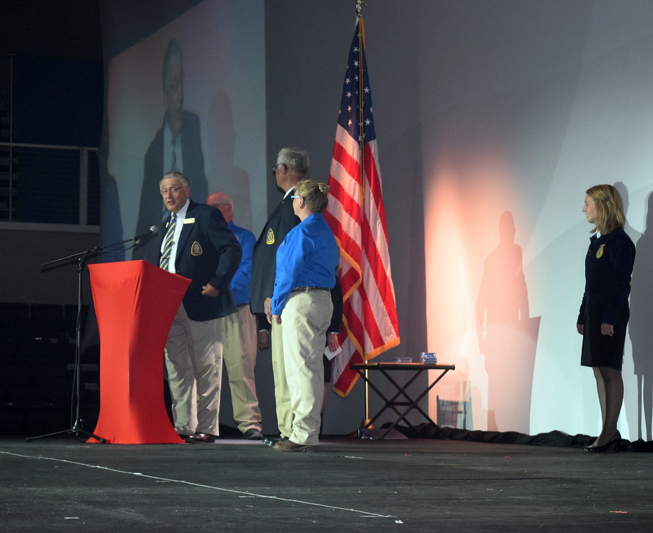 Dr. Larry Case, president of the National FFA Alumni Association, along with members of the Colorado FFA Alumni Association board of directors, greets students at the fifth session of the Colorado FFA State Convention Thursday, June 9, 2016.