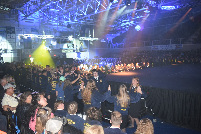 FFA members prepare to welcome the state officers to the stage during the final session of the Colorado FFA State Convention Thursday, June 9, 2016.