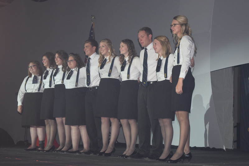 The 2015-16 state officers join together one last time after removing their blue and gold jackets in a retirement ceremony during the final session of the Colorado FFA State Convention Thursday, June 9, 2016. From right; Emma Mortensen, president (Brush); Rayna Hodgson, vice president (Platte Valley); Bryce Funk, secretary (New Raymer); Rachael Latta, treasurer (Cedaredge); Megan Thormodsgard, reporter (Briggsdale); Nick Vollmer, sentinel (Merino);