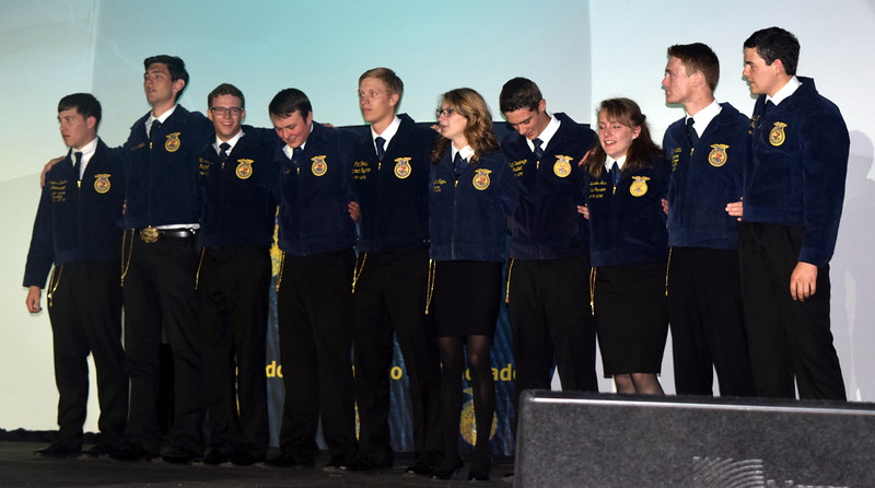 The 2016-17 Colorado FFA State Officers line up on stage after being elected during the closing session of the 88th Annual Colorado FFA State Convention Thursday, June 9, 2016. From right; Gus Gill, president (Merino); Ryan Latta, vice president (Cedaredge); Mercedes McCue, secretary (Limon); Austin Vieselmeyer, treasurer (Holyoke); Megan Capps, reporter (Fruita); Flint Corliss, executive committee member (Stratton);  Samuel Baylie, executive committee member (Meeker); Cade Kanode, executive committee member (Highland); Tucker Millholland (Fruita), executive committee member; and Cullen Stevens, sentinel (Valley).