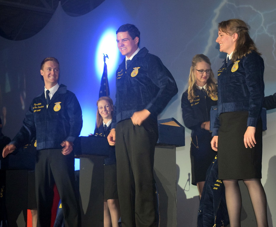 Gus Gill, of the Merino FFA chapter, smiles after putting on his new blue and gold jacket as the newly elected 2016-17 president of the Colorado FFA during the final session of the 88th Annual Colorado FFA State Convention Thursday, June 9, 2016.