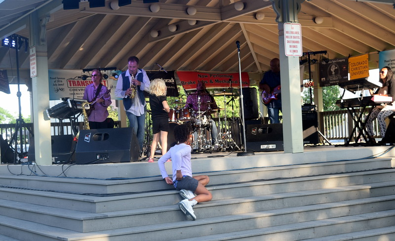 Young fans wanted to be as close to the music as possible as the Dotsero jazz band performed Friday, July 15, 2016, at the Transwest Concerts on the Green...July Jamz concert, put on by Sterling Arts Council, at the Logan County Courthouse Gazebo.