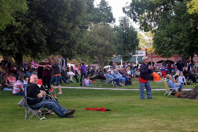 A crowd enjoys the music of Dotsero at the Transwest Concerts on the Green...July Jamz concert, Friday, July 15, 2016, at the Logan County Courthouse Square.