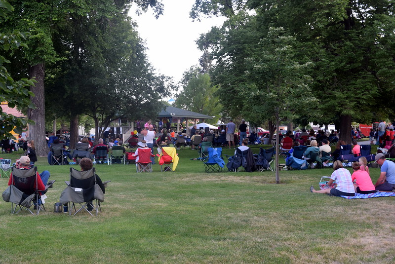 A crowd enjoys the music of Dotsero at the Transwest Concerts on the Green...July Jamz concert, Friday, July 15, 2016, at the Logan County Courthouse Gazebo.