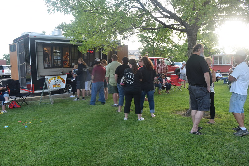 Concertgoers line up at Jerry Dogs BBQ to get a bite to eat at the July Jamz concert Friday, July 15, 2016.