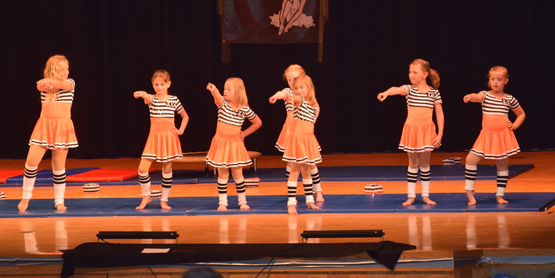 "Jordan Kuehl, Cedi Ball, Faye Lueck, Taylor Fouch, McKinzie Sides, Clare Moos and Bridgette Moos dance to ""Jail House Rock"" at Durante's Dance Studio's spring recital Saturday, June 10, 2017."