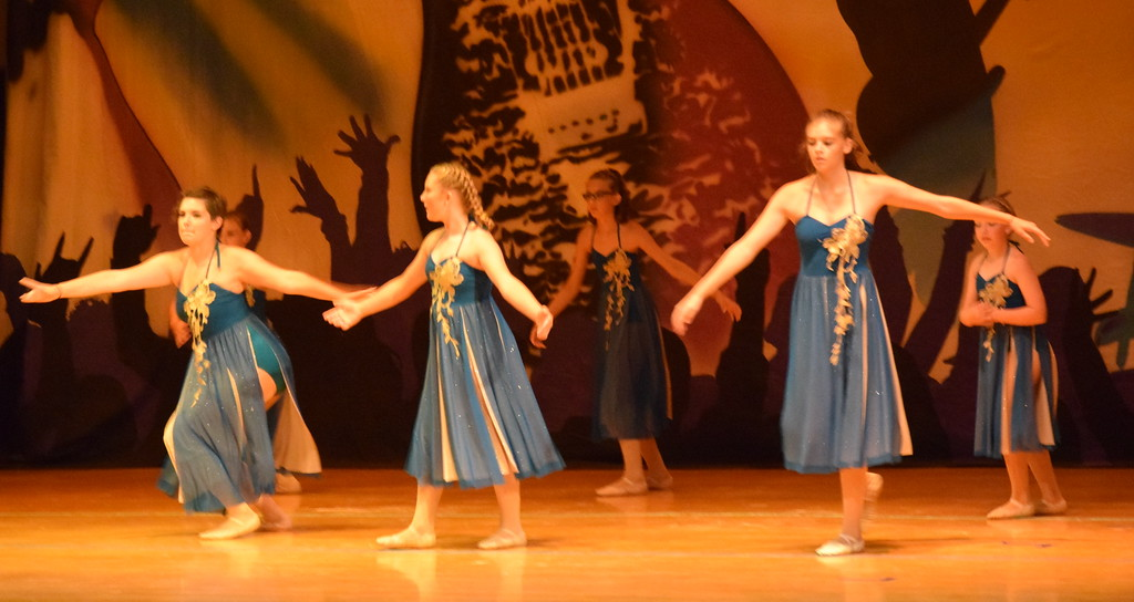 ". Abby Seyfang, Marissa Kujala, Chloe Fisher, Callyn Brecht, Kaina Carrasco, Courtney Canada, Addison Pasko, McKenzie Beck and Makaiden Pace dance to ""Tme After Time\"" during Durante\'s Dance Studio\'s \""Dancing to the 80\'s\"" recital."