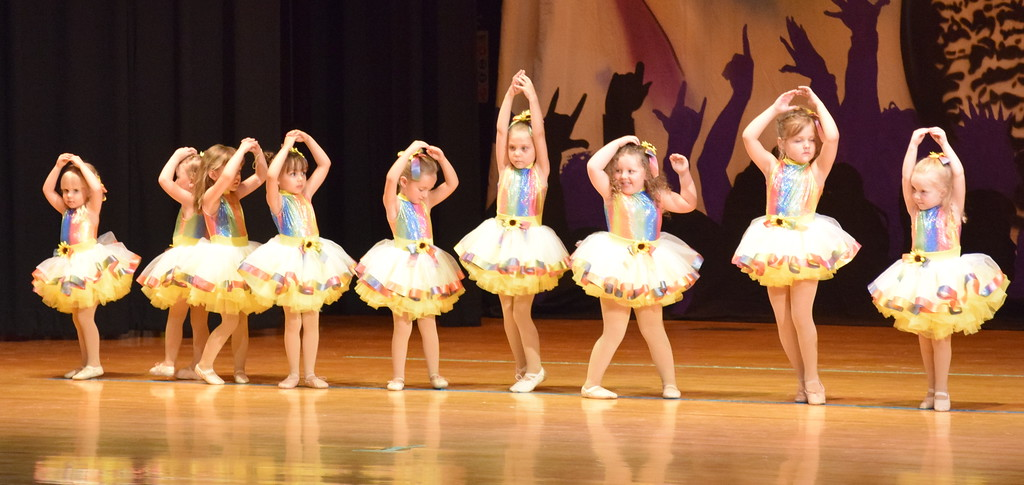 ". Albey Wisdom, Piper Swan, Reni Blecha, Ilaria Raffaeli, Harper Lutz, Arabella Hamner, Kamryn Rossen, Kaitlynn Brandau, Adalyn Sonnenberg, Quincey Lehmkuhl, Harper Roberts, Riley Workman and Brennyn Kailey dance to ""What a Wonderful World\"" during Durante\'s Dance Studio\'s \""Dancing to the 80\'s \"" recital Saturday, June 9, 2018."