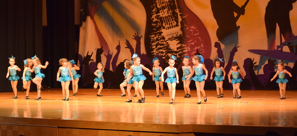 ". Tearsa Finley, Peyton Velk, Caroline Wright, Zoey McKay, Pacyn Stromberger, Adley Miller, Corryn Monheiser, Emma Lerdal, Quinn Seifried, Avery Goeglein, Faith Baray, Amiyah Steele, Kadance Hooton, Joy Soukup, Meritt Ringlein and Josy Schneoper dance to ""Wake Me Up Before We Go Go\"" during Durante\'s Dance Studio\'s \""Dancing to the 80\'s\"" recital Saturday, June 9, 2018."