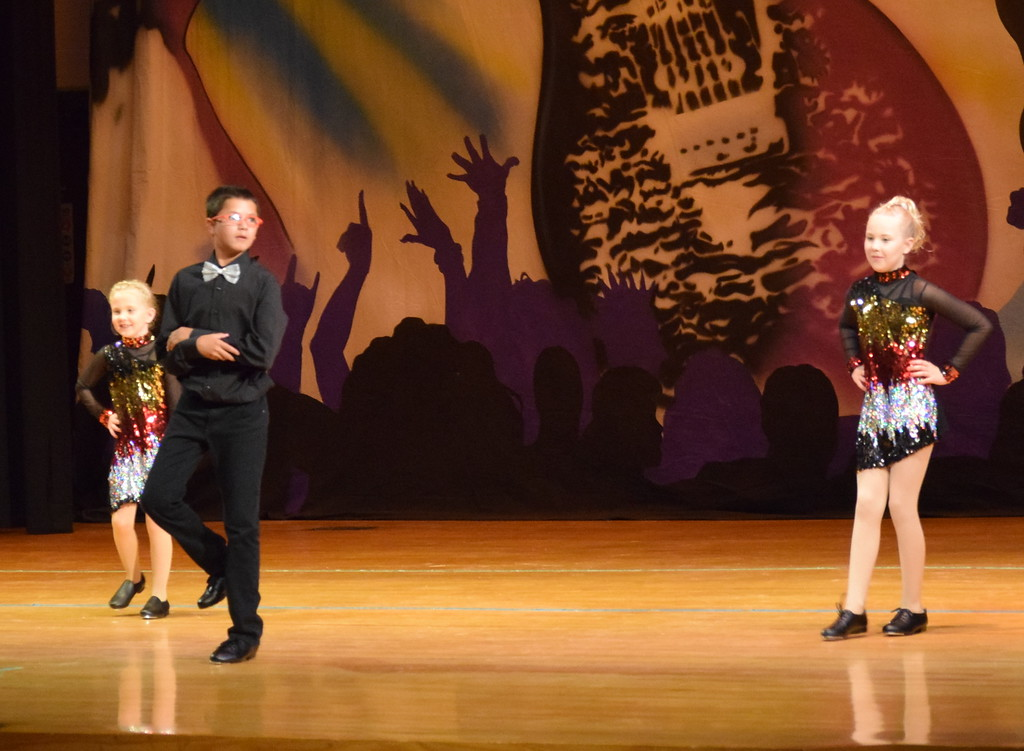 ". Zooey Knorr, Izak Bates and Rylan Knorr dance to ""Sharp Dressed Man\"" during Durante\'s Dance Studio\'s \""Dancing to the 80\'s\"" recital Saturday, June 9, 2018."