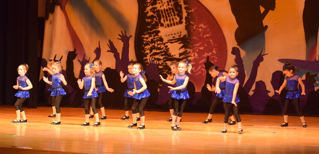 ". Remi Gerlach, Khloe McBride, Landree Ulrich, Brynlee Lock, Taysin Bostron, Lexus Martinez, Alisha Barker-Lopez, Lauryn Kracht, Kate Wright, Tavyn Lock Totten, Braya Kailey and Clair Park dance to ""9 To 5\"" during Durante\'s Dance Studio\'s \""Dancing to the 80\'s\"" recital Saturday, June 9, 2018."
