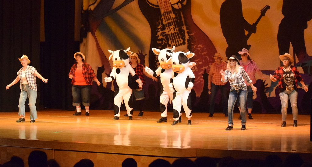 ". Tina Zimmerman, Tiffany Blecha, Misty Canada, Suzy Pace, Joyce Dizmang, Randy Finley, Samantha Swan, Melissa Wahlert, Lela County and Wendy Lozier dance to ""Honey I\'m Good\"" during Durante\'s Dance Studio\'s \""Dancing to the 80\'s\"" recital Saturday, June 9, 2018."