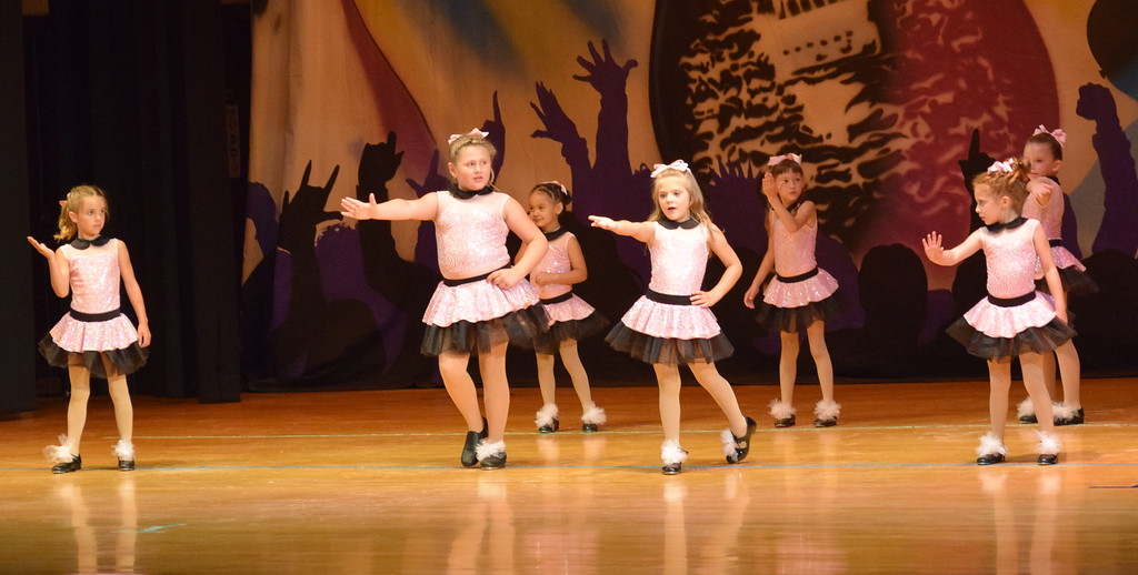 ". Darby Webb, Daisy Barkley, Layla Lopez, Katherine Archuleta, Mckenna Padilla, Haley Troyer, Haven Cox and Catherine Gerk dance to ""Don\'t Be Cruel\"" during Durante\'s Dance Studio\'s \""Dancing to the 80\'s\"" recital Saturday, June 9, 2018."