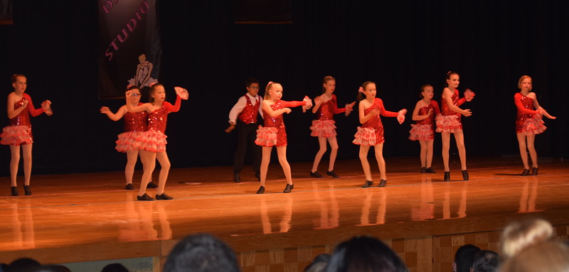 "Shylah Pace, Morgan Lambert, Marissa Kujala, Kayle Unrein, ShayLeigh Ulrich, Lydia Boxberger, Izak Bates, Addison Prusha, Macie Doherty and Teagan Tennant dance to ""Little Red Wagon"" during Durante Dance Studio's spring recital, ""Wishes From Above,"" Friday, June 3, 2016."