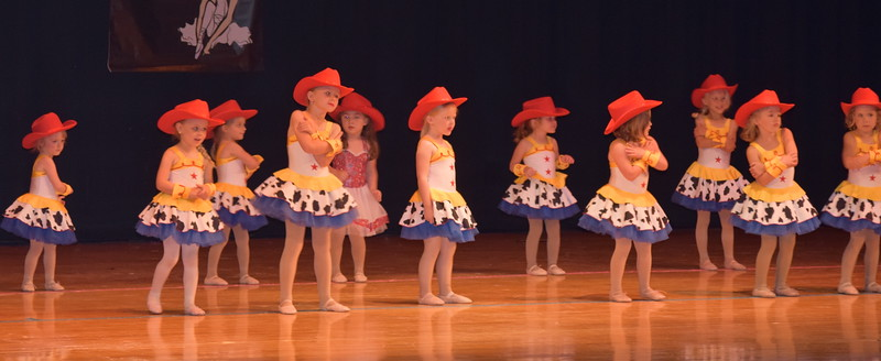 "Kira Nelson, Edisyn Teply, Jenna Hoffner, Taya Stromberger, Jules Trum, Braylin Herman, Sophie Daniel, Jeorjia Stroyek, Adilyn Priddy, Jemma Horton, Eadlyn Sprague and Kynlea Nelson dance to ""You've Got a Friend in Me"" during Durante Dance Studio's spring recital, ""Wishes From Above,"" Friday, June 3, 2016."