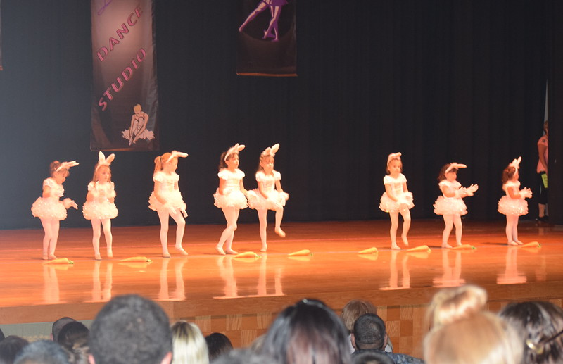 "Braya Kailey, BrayLynn Gower, Emily Davis, Makenzie Sides, Melanie Monson, Andi Ball, Emerson Ross, Macie Rhodes and Isabella Finkelstein dance to ""Just How Fast Is That Easter Bunny""  during Durante Dance Studio's spring recital, ""Wishes From Above,"" Friday, June 3, 2016."