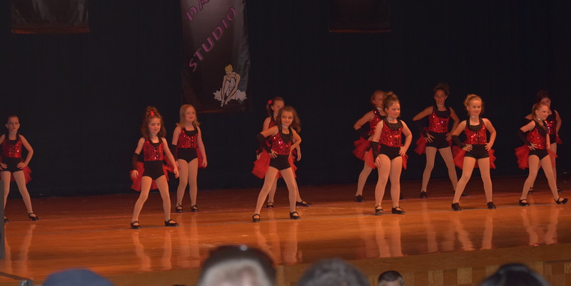 "Kaebrynn Heller, Bailey Workman, Hayden Walker, Katie Roberts, Josette Kerst, Taryn Seifried, Kaina Carrasco, Courtney Canada, Mackenzie Beck, Kami Neel, Taylor Swan and Paige McCanley dance to ""My Selfish Heat"" during Durante Dance Studio's spring recital, ""Wishes From Above,"" Friday, June 3, 2016."